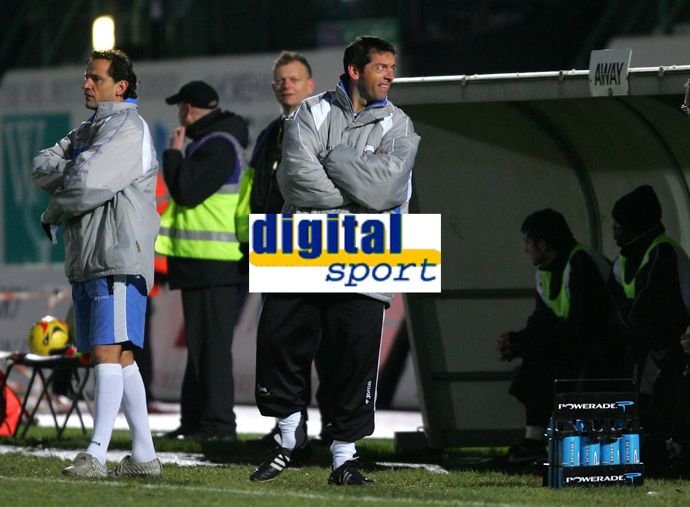 Photo: Frances Leader.<br />Brighton & Hove Albion v Derby County. Coca Cola Championship. 26/11/2005.<br />Derby's manager Phil Brown (R) laughs as Brighton fans chant that he is going to get the sack.