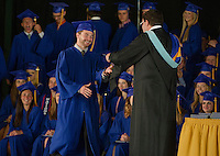 Zach Poisson receives his diploma from Principal Peter Sawyer during Gilford High School commencement on Saturday morning at Bank of NH Meadowbrook Pavillion.  (Karen Bobotas/for the Laconia Daily Sun)