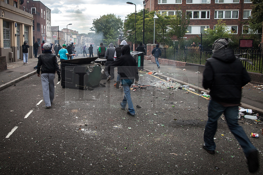 © Licensed to London News Pictures . 08/08/2011 . London , UK . Riots on Clarence Road on the Pembury Estate in Hackney during a 3rd night of rioting and looting in London , which followed a protest against the police shooting of Mark Duggan in Tottenham . Photo credit : Joel Goodman/LNP