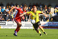 Burton Albion  forward Liam Boyce (27) and Scunthorpe United defender Cameron Burgess (21) during the EFL Sky Bet League 1 match between Burton Albion and Scunthorpe United at the Pirelli Stadium, Burton upon Trent, England on 29 September 2018.