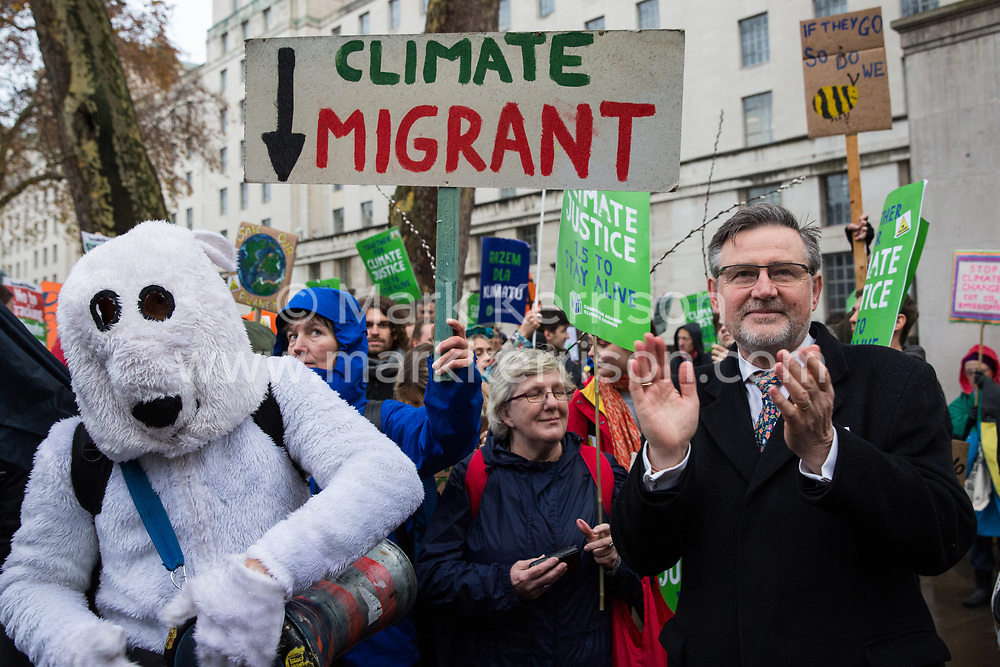 London, UK. 1st December, 2018. Barry Gardiner MP, Shadow Secretary of State for International Trade and Shadow Minister for International Climate Change, prepares to address the Together for Climate Justice demonstration against Government policies in relation to climate change, including Heathrow expansion and fracking. Following a rally outside the Polish embassy, chosen to highlight the UN's Katowice Climate Change Conference which begins tomorrow, protesters marched to Downing Street.
