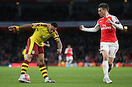 Andre Gray of Burnley miss times a cross with Laurent Koscielny of Arsenal marking him. The Emirates FA cup, 4th round match, Arsenal v Burnley at the Emirates Stadium in London on Saturday 30th January 2016.<br /> pic by John Patrick Fletcher, Andrew Orchard sports photography.