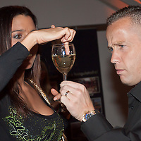 """Reka Rubint (L) and Norbert """"Norbi"""" Schobert (R) concentrate on a glass of champagne during the birthday party of Hungarian celebrity Peter Hajdu (not in picture) celebrating the 35th birthday of the TV personality in Budapest, Hungary on April 08, 2010. ATTILA VOLGYI"""