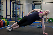 Partially-sighted skiing paralympian from the Sochi Olympics, Kelly Gallagher trains in the gym at the Sports Institute, University of Ulster, Northern Ireland, UK. Practicing side-stands she starts a new training regime for the forthcoming winter season. Kelly Marie Gallagher, MBE is a Northern Irish skier and the first athlete from Northern Ireland to compete in the Winter Paralympics. Gallagher won Britain's first ever Winter Paralympic gold medal during Sochi 2014.