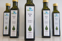 © London News Pictures. 15/05/15. London, UK. Hemp oil on sale at the UK's first cannabis pharmacy, Twickenham, West London. Carun UK, which will be based in Twickenham, London, aims to 'harness the healing super-powers of hemp' which is claims is the 'ultimate skin saviour and well-being booster'.<br />  Photo credit: Laura Lean/LNP