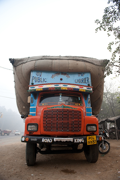 A truck standing with a load at Punjab Highway.