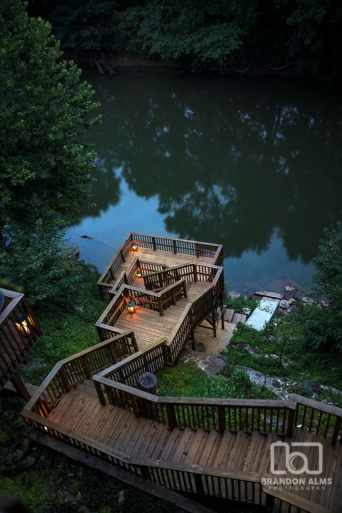 Huge staircase from a river front property that leads to the river. Photo by Brandon Alms Photography.
