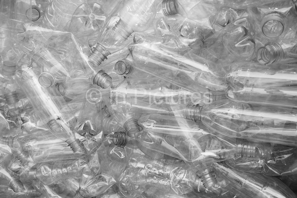 EDITORS NOTE: Image has been converted to black and white. Plastic water and drinks bottles for recycling on 1st July 2020 in London, United Kingdom. Single-use plastics, or disposable plastics, are used only once before they are thrown away or recycled. These items are things like soda and water bottles and most food packaging. The world produces hundreds of millions of tons of plastic every year, most of which cannot be recycled.