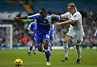Photo: Andrew Unwin.<br />Leeds United v Cardiff City. Coca Cola Championship.<br />10/12/2005.<br />Cardiff's Cameron Jerome (L) tries to get away from Leeds' Matthew Kilgallon (R).