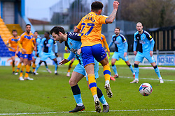 Wes Hoolahan of Cambridge United knocks Tyrese Sinclair of Mansfield Town off the ball - Mandatory by-line: Ryan Crockett/JMP - 20/02/2021 - FOOTBALL - One Call Stadium - Mansfield, England - Mansfield Town v Cambridge United - Sky Bet League Two