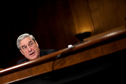 May 17, 2017 - FILE PHOTO - The Justice Department on Wednesday named ROBERT MUELLER as special counsel to oversee the department's investigation into Russian meddling in the 2016 election. Mueller III served as FBI director from 2001 through 2013. Pictured: June 8, 2011 - Washington, District of Columbia, U.S. - FBI Director ROBERT MUELLER appears before a Senate Judiciary Committee hearing on the President's request to extend his service as director until 2013. (Credit Image: © Pete Marovich/ZUMAPRESS.com)