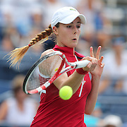 Alize Cornet, France, in action against Victoria Azarenka, Belarus, during the Women's Singles competition at the US Open. Flushing, New York, USA. 31st August 2013. Photo Tim Clayton