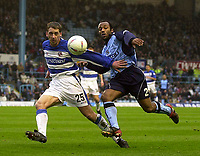 Photo. Glyn Thomas.<br /> Coventry City v Reading. Nationwide Division 1.<br /> Highfield Road, Coventry. 27/03/2004.<br /> Reading's Ricky Newman (L) battles for the ball with Julian Joachim.