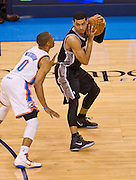 June 2, 2012; Oklahoma City, OK, USA; Oklahoma City Thunder guard Russell Westbrook (0) applies pressure to San Antonio Spurs guard Danny Green (4) during a playoff game  at Chesapeake Energy Arena.  Thunder defeated the Spurs 109-103 Mandatory Credit: Beth Hall-US PRESSWIRE