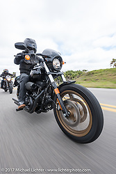 Anthony Paggio of Laguna Niguel, CA test riding a 2017 Harley-Davidson Low Rider S from the large Demo Fleet that was brought in just for Daytona Beach Bike Week as he heads south on AIA. FL. USA. Tuesday, March 14, 2017. Photography ©2017 Michael Lichter.