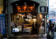 "Yushin wale meat shop, Asakusa, Tokyo. Next door is a whale meat restaurant, also called Yushin. The meat for both premises comes from the factory vessel Nisshin Maru, which carries out controversial ""scientific whaling research"" in the Southern Ocean every year, killing hundreds of whales in the Southern Ocean Whale Sanctuary. After the whaling fleet arrive back in Japan, the whale meat is sold off to shops like Yushin. Critics, such as Greenpeace, say that the scientific research programme is really just commercial whaling in disguise."