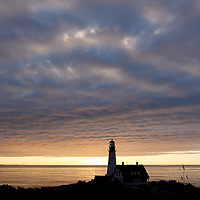 """Portland Head Light Station is a lighthouse located in Cape Elizabeth, Maine, USA. It has been called the """"Most photographed lighthouse in North America,"""" and visited by nearly one million people per year."""