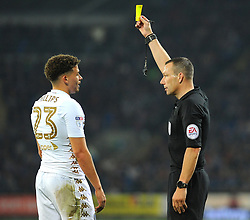 Referee Kevin Friend gives a yellow card to Kalvin Phillips of Leeds United -Mandatory by-line: Nizaam Jones/JMP - 26/09/2017 -  FOOTBALL - Cardiff City Stadium - Cardiff,Wales -  Cardiff City v Leeds United - Sky Bet Championship