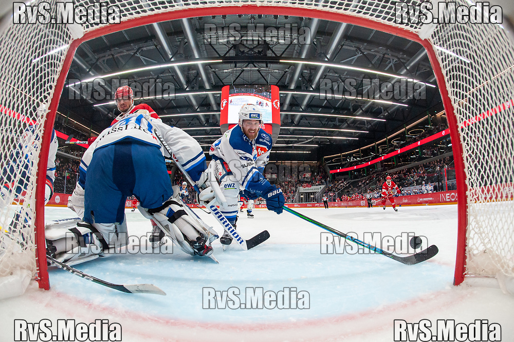 LAUSANNE, SWITZERLAND - OCTOBER 01: Yannick Weber #6 of ZSC Lions tries to save the puck from the line during the Swiss National League game between Lausanne HC and ZSC Lions at Vaudoise Arena on October 1, 2021 in Lausanne, Switzerland. (Photo by Monika Majer/RvS.Media)