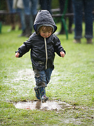© Licensed to London News Pictures. 10/07/2012..Harrogate, England...Heavy rain and mud made for an interesting start to England's premier agricultural show which opened it's gates today for the start of three days of showcasing the best in British farming and the countryside...The event, which attracts over 130,000 visitors each year is the 154th show and displays the cream of the country's livestock and offers numerous displays and events and gives the chance to see many different countryside activities...Photo credit : Ian Forsyth/LNP