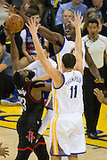 Golden State Warriors forward Draymond Green (23) gets his hand on the ball (and foot in the crotch) as Houston Rockets guard James Harden (13) attempts to finish a lay up during the second quarter at Oracle Arena in Oakland, Calif., on December 1, 2016. (Stan Olszewski/Special to S.F. Examiner)