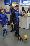 AFC Wimbledon midfielder Anthony Hartigan (8) kicking ball in chaning room during the EFL Sky Bet League 1 match between AFC Wimbledon and Doncaster Rovers at the Cherry Red Records Stadium, Kingston, England on 9 March 2019.