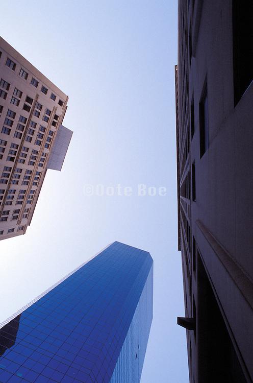 upward view of 3 office buildings