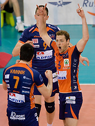 Matevz Kamnik, Dejan Vincic,  Daniel Lewis  of ACH celebrate at 2nd Semifinal match of CEV Indesit Champions League FINAL FOUR tournament between ACH Volley, Bled, SLO and Trentino BetClic Volley, ITA, on May 1, 2010, at Arena Atlas, Lodz, Poland. Trentino defeated ACH 3-1. (Photo by Vid Ponikvar / Sportida)