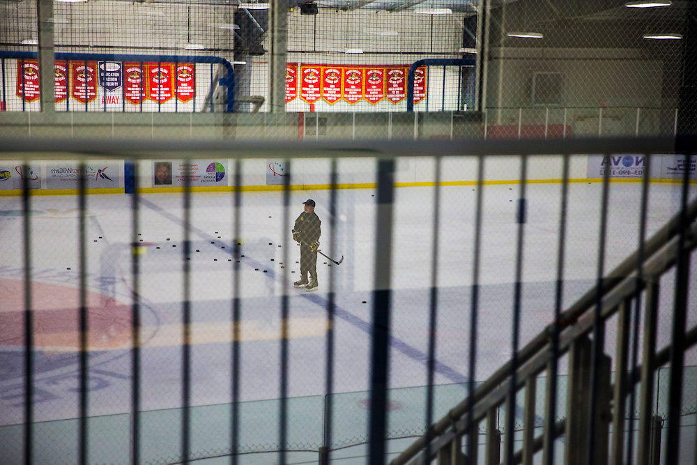 Head Coach Steve Hyjek stands in the middle of the rink while a practice drill is played out at Prince William Ice Rink in Woodbridge, VA on January 22, 2014. Cordova had grab Talbot's warm up jersey on accident in the locker room.