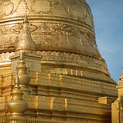 Gold stupa at Soon Oo Pon Nya Shin Pagoda. Sitting on top of Nga-pha Hill, Soon Oo Pon Nya Shin Pagoda is one of multiple pagodas and temples in the religious district of Sagaing, near Mandalay. The original pagoda dates to 674.