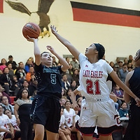 Cassisdy Begay (21) of Crownpoint defends Lashawna Brown's (5) of Thoreau shot in Crownpoint on Thursday. Crownpoint won 66-58.