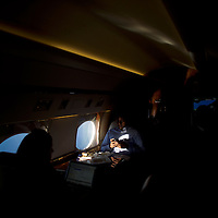 A staff member of Democratic Presidential nominee Hillary Clinton uses a smartphone on the press jet while flying back to New York after a rally at John Marshall High School in Cleveland, Ohio August 17, 2016.  REUTERS/Mark Makela