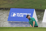 Branden Grace (RSA) chips from a bunker at the 17th green during Saturay's Round 3 of the 2014 BMW Masters held at Lake Malaren, Shanghai, China. 1st November 2014.<br /> Picture: Eoin Clarke www.golffile.ie