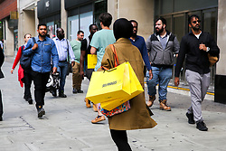 © Licensed to London News Pictures. 09/08/2019. London, UK. A shopper with Selfridges shopping bags on Oxford Street in London as UK retailers experience worst July since sales records began. Photo credit: Dinendra Haria/LNP