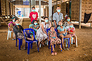 03 MARCH 2104 - MAE KASA, TAK, THAILAND: TB patients and their family members watch television at the Sanatorium Center for Border Communities in Mae Kasa, about 30 minutes north of Mae Sot, Thailand. The Sanatorium provides treatment and housing for people with tuberculosis in an isolated setting for about 68 patients, all Burmese. The clinic is operated by the Shoklo Malaria Research Unit and works with several other NGOs that assist Burmese people in Thailand. Reforms in Myanmar have alllowed NGOs to operate in Myanmar, as a result many NGOs are shifting resources to operations in Myanmar, leaving Burmese migrants and refugees in Thailand vulnerable. Funding cuts could jeopardize programs at the clinic. TB is a serious health challenge in Burma, which has one of the highest rates of TB in the world. The TB rate in Thailand is ¼ to ⅕ the rate in Burma.        PHOTO BY JACK KURTZ