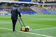 AFC Wimbledon grounds man about to paint the lines at Plough Lane during the EFL Sky Bet League 1 match between AFC Wimbledon and Sunderland at Plough Lane, London, United Kingdom on 16 January 2021.