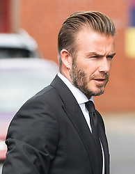 © Licensed to London News Pictures. 27/08/2015. Bury, UK.  Picture shows David Beckham. The funeral of Neville Neville father of footballers Gary & Phil Neville & England net ball coach Tracey has taken place today at Bury Parish church. Neville died in Australia after being taken ill on a visit to support his daughter  Tracey.  Photo credit: Andrew McCaren/LNP