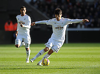 Swansea City's Ki Sung-Yueng in action during todays match  <br /> <br /> Photographer Ashley Crowden/CameraSport<br /> <br /> Football - Barclays Premiership - Swansea City v Manchester United - Saturday 21st February 2015 - Liberty Stadium - Swansea<br /> <br /> © CameraSport - 43 Linden Ave. Countesthorpe. Leicester. England. LE8 5PG - Tel: +44 (0) 116 277 4147 - admin@camerasport.com - www.camerasport.com