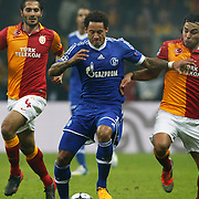 Galatasaray's Hamit Altintop (L), Selcuk Inan (R) and Schalke 04's Jermaine Jones (C) during their UEFA Champions League Round of 16 First Leg match Galatasaray between Schalke 04 at the TT Arena Ali Sami Yen Spor Kompleksi in Istanbul, Turkey on Wednesday 20 February 2013. Photo by Aykut AKICI/TURKPIX