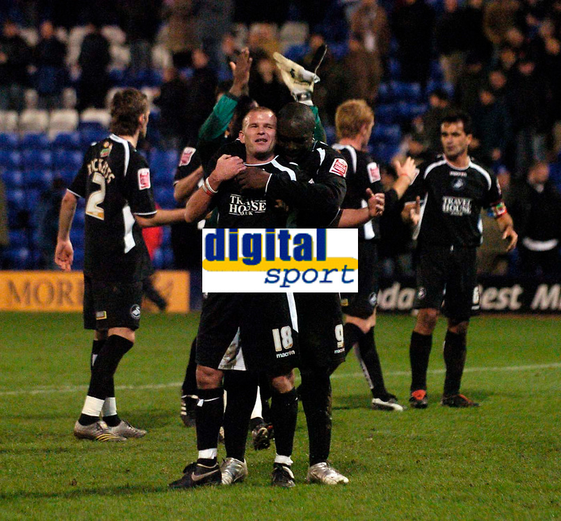 Photo: Jed Wee.<br />Tranmere Rovers v Swansea City. Coca Cola League 1.<br />26/11/2005.<br />Swansea's Andy Robinson (L) celebrates with Adebayo Akinfenwa at the final whistle as they salvage a draw.