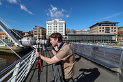 Newcastle based photographer Max Milne takes pictures of the Bridges over Tyne river from Millenium bridge on Tuesday, March 16, 2021. Spanning the Tyne, modern Gateshead Millennium Bridge, noted for its unique tilting aperture, which is a symbol of the 2 cities. (Photo/ Vudi Xhymshiti)