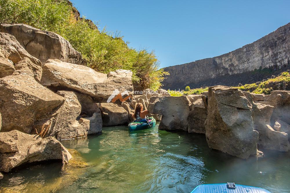 Woman kayaking in the Snake River canyon near Twin Falls, Idaho. MR