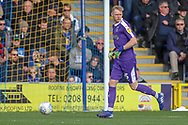 AFC Wimbledon goalkeeper Aaron Ramsdale (35) dribbling during the EFL Sky Bet League 1 match between AFC Wimbledon and Doncaster Rovers at the Cherry Red Records Stadium, Kingston, England on 9 March 2019.