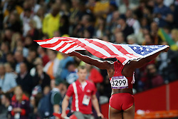 Olympics - London 2012 Olympic Games - Athletics -  4/8/12.Athletics - Womens 100m - Carmelita Jeter (USA)celebrates at the women's 100m.© pixathlon