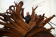 Chinese artist Ai Weiwei poses with his work  Martin 2019 at the opening of  his new exhibition Ai Weiwei: Roots at the Lisson Gallery, London, United Kingdom on 1st October 2019.
