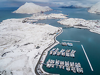 Aerial view of harbour in Unalaska covered with snow at winter, USA.