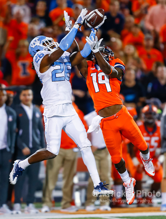 CHAMPAIGN, IL - SEPTEMBER 10: Dominquie Green #26 of the North Carolina Tar Heels battles for the pass against Justin Hardee #19 of the Illinois Fighting Illini at Memorial Stadium on September 10, 2016 in Champaign, Illinois. (Photo by Michael Hickey/Getty Images) *** Local Caption *** Dominquie Green; Justin Hardee