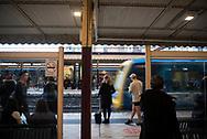 Melbourne, Australia - August 24, 2017: People wait on a train station platform at Flinders Street Station, the central transportation hub in Melbourne.