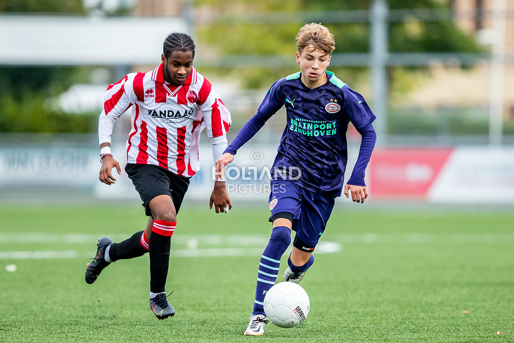 ALPHEN AAN DEN RIJN, NETHERLANDS - OCTOBER 2: (L-R) #10 Lebron Campagne (Alphense Boys), #2 Jari Horsten (PSV) during the Divisie 1 A NAJAAR u15 match between Alphense Boys and PSV at Sportpark De Bijlen on October 2, 2021 in Alphen aan den Rijn, Netherlands