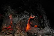 Glowing wood embers in a fire